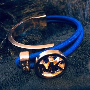 Michael Kors gold logo bracelet with blue cord
